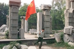 A People's Liberation Army soldier at the ruins of the Old Summer Palace (Yuanmingyuan) as he and his comrades visited the palace to commemorate the anniversary of the May Fourth Movement.