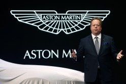 Aston Martin CEO Andrew Palmer addresses the media during the 85th International Motor Show in Geneva, March 3, 2015.