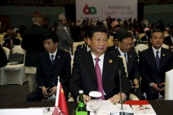 Chinese President Xi Jinping waits to deliver a speech at a plenary session during the Asian-African Conference in Jakarta, April 22, 2015.