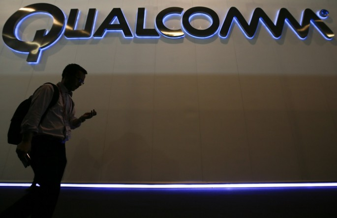 Man walks past Qualcomm stand while attending the Mobile World Congress in Barcelona March 3, 2015. Ninety thousand executives, marketers and reporters gather in Barcelona this week for the telecom op