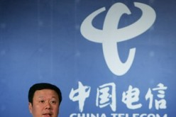 Chairman and chief executive of China Telecom Corp. Ltd. Wang Xiaochu speaks during a news conference in Hong Kong.