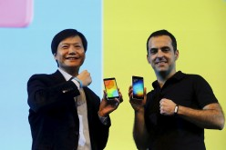 Xiaomi executives Lei Jun and Hugo Barra display Mi 4i phones during its launch in New Delhi.
