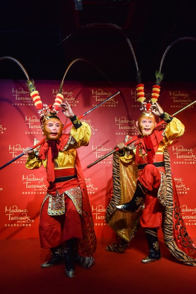 Who is the real Monkey King? Chinese actor Zhang Jinlai making a pose with his wax duplicate in an exhibit at Madame Tussauds Beijing.