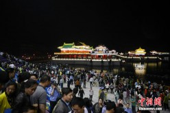 Large crowds of tourists watch the multimedia laser light show