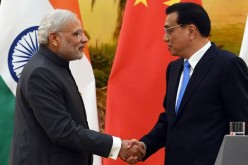 Indian Prime Minister Narendra Modi shakes hands with Chinese Premier Li Keqiang after a joint press conference in the Great Hall of the People in Beijing.