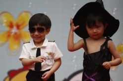 Photo taken on May 29, 2015 shows children at Beijing's Donghuamen Kindergarten putting on a fashion show to celebrate the upcoming Children's Day on June 1.