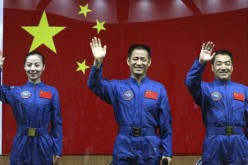 Shenzhou-10 crew (from left) Wang Yaping, Nie Haisheng and Zhang Xiaoguang during their arrival at Tiangong-1 Space Station.
