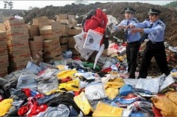 Chinese authorities prepare to destroy fake goods confiscated by police.