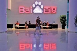 A visitor walks past the lobby of Baidu headquarters in Beijing.