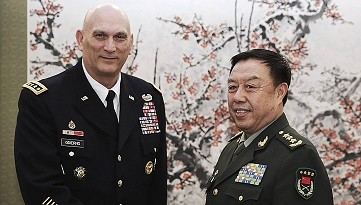 Fan Changlong, vice chairman of China's Central Military Commission, meets with U.S. Army Chief of Staff General Ray Odierno at Bayi Building in Beijing on Feb. 21, 2014.