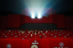 Patrons watch a 3D movie at an IMAX theater in Beijing in 2012.