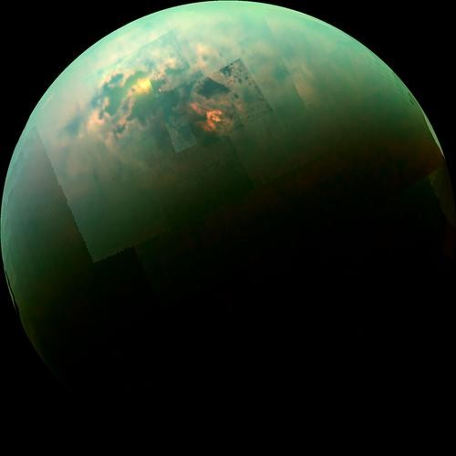 This near-infrared, color mosaic from NASA's Cassini spacecraft shows the sun glinting off of Titan's north polar seas.