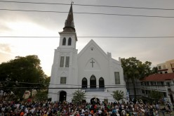 A crowd gathers outside the Emanuel African Methodist Episcopal Church following a prayer vigil nearby in Charleston, South Carolina, June 19, 2015.