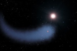 This artist's concept shows the enormous comet-like cloud of hydrogen bleeding off of the warm, Neptune-sized planet Gliese 436b just 30 light-years from Earth.