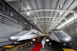 Two trains are on display while awaiting operation at the production base for Beijing-Shanghai bullet train in Qingdao.