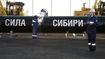 Welders join the first link in the Power of Siberia main gas pipeline in a ceremony attended by Russian President Vladimir Putin, held at Namsky Highway near Us Khatyn village.