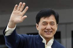 Jackie Chan is seen waving his hand to his fans.