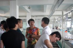 Party Secretary Bao Xiuying of Kaihua County visits Zhejiang Jinshilang Photoelectric factory in Hangzhou City.