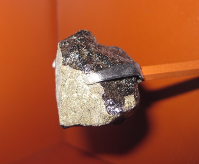 This Nakhla Martian meteorite apparently holds traces of opal that can lead to evidence of microbial life.