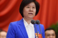 Shen Yueyue speaks during the third session of the 12th National People's Congress held at the Great Hall of the People on March 8, 2015.