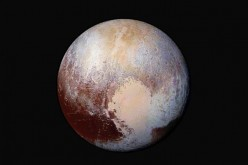 This NASA's photo of Pluto was made from four images from New Horizons' Long Range Reconnaissance Imager (LORRI) combined with color data from the Ralph instrument in this enhanced color global view.