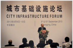 Huang Qifan, mayor of Chongqing, speaks before delegates of city infrastructure forum in 2013.