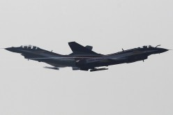 Two J-10 fighter jets from the People's Liberation Army Air Force fly in formation above the skies of Zhuhai, Guangdong Province, on Nov. 13, 2012.