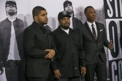 Corey Hawkins (R), who portrays Dr. Dre, and O'Shea Jackson Jr. (L), who portrays Ice Cube, pose with producer Ice Cube at the premiere of ''Straight Outta Compton'' in Los Angeles, California August 10, 2015.