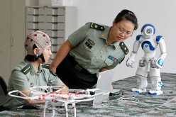Chinese scientists have develop a mind-controlled robotic suit.