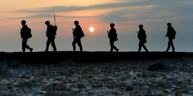South Korean Marines patrol along a bank of a shore on Yeonpyeong island just south of Northern Limit Line (NLL), South Korea, August 23, 2015.