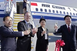 Officials of Civil Aviation Administration of China (CAAC) and Air China celebrate the delivery of a Boeing Next-Generation 737-800.