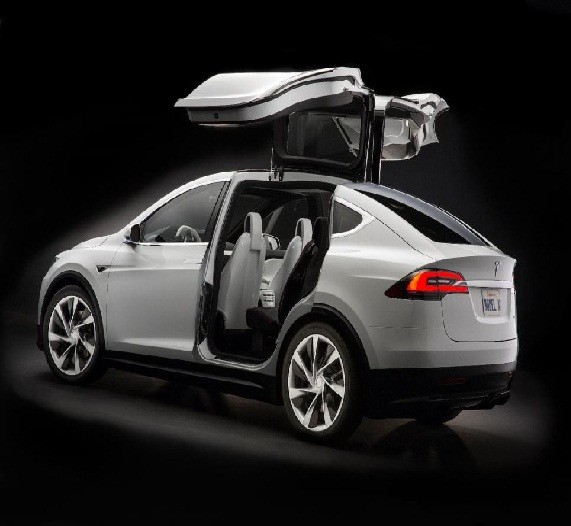 A photo of the Tesla Model X Signature showing its unique rear Falcon Door.