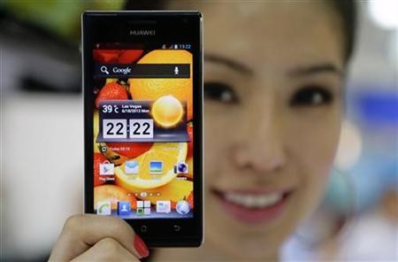 A model shows off a Huawei Ascend P1 smartphone.
