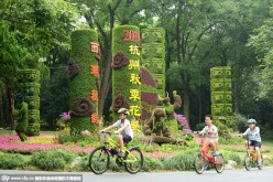 Kids ride bikes around various plants at the botanical garden in Hangzhou, southeast China's Zhejiang Province, on Aug. 30, 2015.