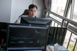 A man working at his computer in his office in Hangzhou, Zhejiang Province.