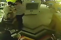 A CCTV recording shows Zhu, a young waiter at Mr. Hot Pot in Wenzhou, pouring hot water on the female diner, Lin.