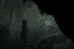 A silhouette of Mowgli standing on tree branches has been featured in Jon Favreau's