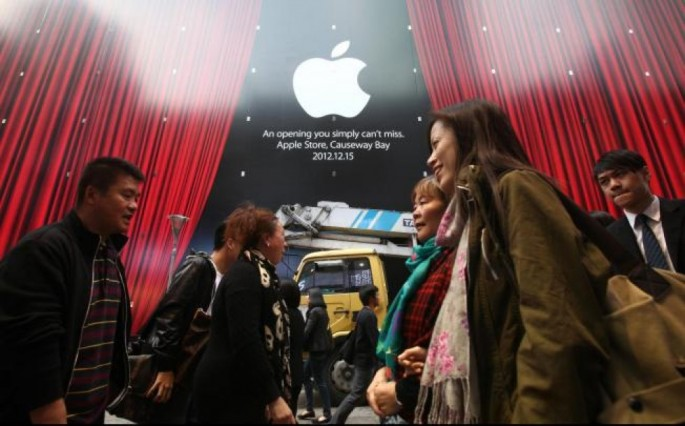 Shoppers walk past an Apple Store at Hysan Place in Causeway Bay, Hong Kong.