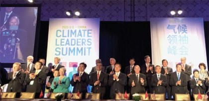 "Local officials from China and the United States cheer after signing the Climate Leaders declaration at the ""China-U.S. Climate-Smart/Low Carbon Cities Summit,"" held on Sept. 15-16, in Los Angeles."