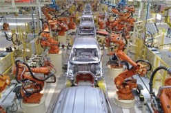 Automated workers or robots work at an automobile manufacturing facility in Tianjin.