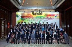 Participants from different countries pose for a picture during the 8th ICT Forum held in June in Macao.