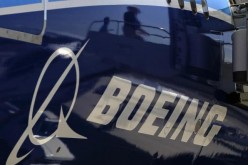 The Boeing logo is seen on a Boeing 787 Dreamliner airplane in Long Beach, California, March 14, 2012.
