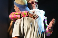 Openly gay Elton John hugs
