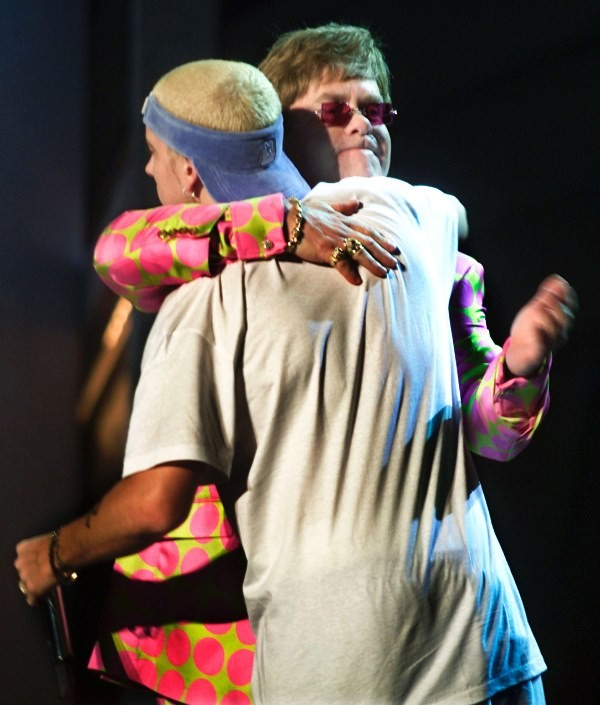 "Openly gay Elton John hugs ""Rap God"" singer Eminem after they performed the song ""Stan"" at the 43rd annual Grammy Awards."
