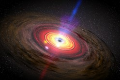 A still frame from a movie, illustrating an active galactic nucleus, with jets of material flowing from out from a central black hole.