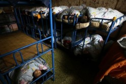 Some left-behind children sleep in dorms in their kindergartens because their parents leave them to work in the city.