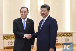 Chinese President Xi Jinping shakes hands with U.N. Secretary-General Ban Ki-moon in Beijing, Sept. 3, 2015.
