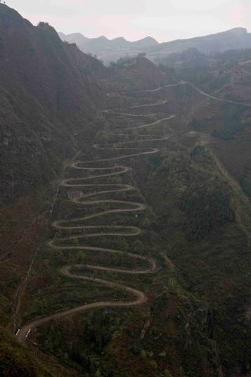 "A photo shows the famous ""24 Zig,"" a zigzag road in Qinglong, rural Guizhou Province."