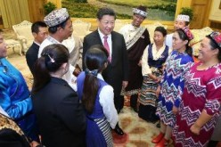President Xi Jinping meets with 13 outstanding grassroots ethnic solidarity representatives at the Great Hall of the People in Beijing.