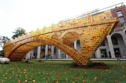 "Chinese artist Shu Yong's ""golden bridge"" structure took inspiration from the well-known Zhaozhou Bridge."